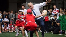 Boris Johnson rugby tackles a child