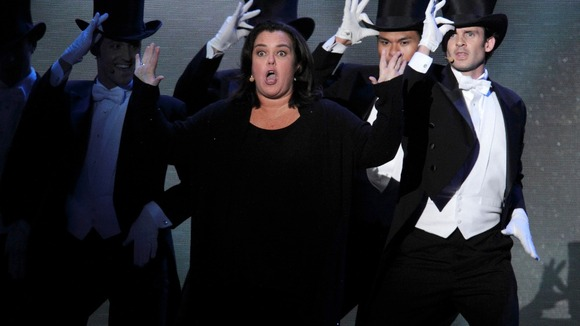 Rosie O'Donnell performs on stage.