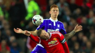 Josh Yorwerth competes with Wayne Rooney's during Ipswich's Capital One Cup defeat to Manchester United last month.