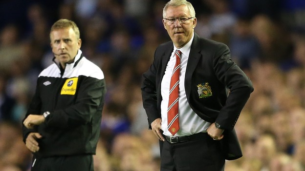 Sir Alex Ferguson (right) watches his Man United team slide to an opening defeat by Everton.
