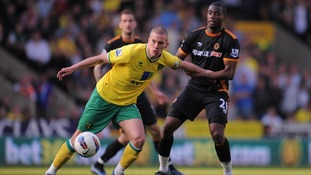 Bassong in action against Steve Morison last season