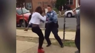Police officer shows off her moves in dance off with teenager