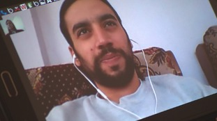 Ahmed talks to his family via video call