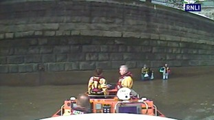 Girl and two adults rescued as Thames rises