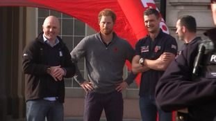 Prince Harry greets wounded veterans after 1,000 mile trek