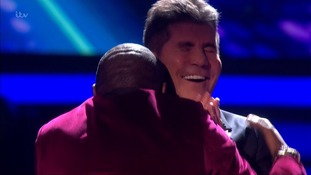 X Factor: Simon Cowell 'headbutted' as he gets a kiss from Anton Stephans