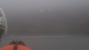 Cliff casualty flown to hospital following a foggy search from emergency service teams