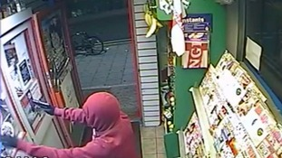 Footage shows moment robbers armed with 'high-powered pellet gun' storm corner shop and shoot man in eyes