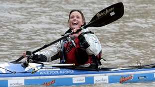 Sarah Outen smiles at her supporters as she arrives back in London on the Thames