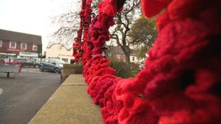 War memorial decorated with 1500 knitted poppies