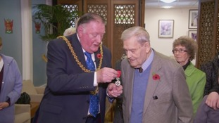 Jack MacDowall being presented with the Legion d'Honneur