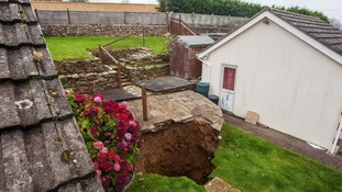 100ft giant sinkhole swallows up pensioner's garden in Cornwall