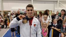 Max Whitlock poses with his medal in Basildon tonight.
