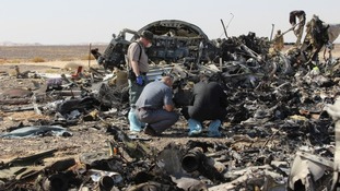 Investigators are examining 'black boxes' taken from the flight