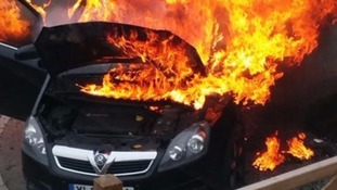 Mum rescues baby from car moments before it bursts into flames