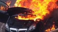 Lisa's car fully ablaze moments after she pulled her baby son from it.