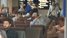 Passengers wait for news at Bristol airport