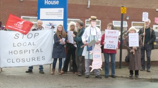 Protestors gathered to oppose to decision to close two community hospitals.