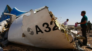 Debris at the site where a Russian aircraft crashed in Egypt's Sinai Peninsula near El Arish city.