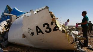 Debris at the site where a Russian aircraft crashed in Egypt's Sinai Peninsula near El Arish city.