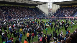 Preston fans invaded the pitch after their win over Chesterfield