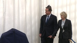Prime Minster David Cameron arrives at the service today.