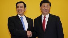 Chinese President Xi Jinping shakes hands with Taiwan's President Ma Ying-jeou
