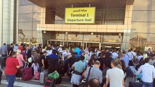 Passengers outside the terminal