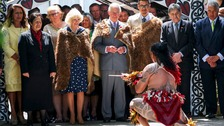 Prince Charles and Camilla are greeted by a Maori warrior