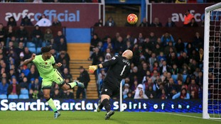 Manchester City's Raheem Sterling (left) has his header saved by Aston Villa goalkeeper Brad Guzan