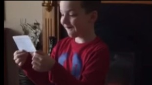 Young boy breaks down in tears after being told he is going to be a big brother by his mother