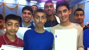 Students together with their GCSE results