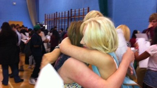 Students embrace as they receive their results