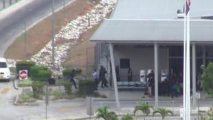 riot police entering the facility