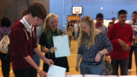 Students open their GCSE results