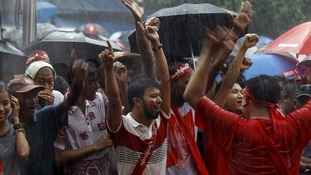 Voters dance in the street as early election results are announced.
