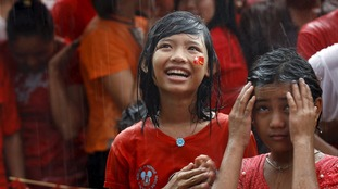 Rain did not stop NLD supporters smiling as they waited for the final results.