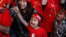 Supporters celebrate as they watch the results in Yangon.