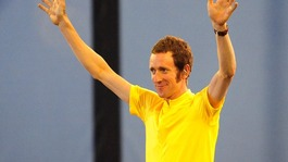 Wiggins waves to the crowds during the Olympic Opening Ceremony