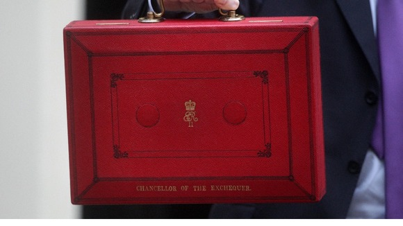 Chancellor of the Exchequer George Osborne holds up his ministerial red box in 2011