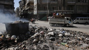 Smoke clears after residents burn rubbish in Aleppo's streets