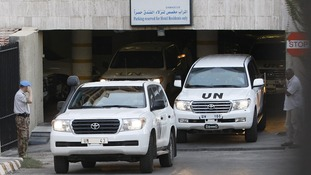 UN vehicles transport members of the United Nations observers mission out of Damascus as they leave Syria