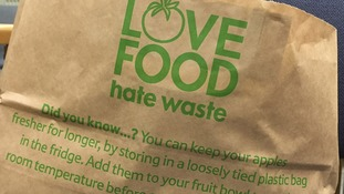 One of the Tesco paper bags being handed out at a store in London