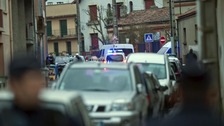 French police secure the area where they exchanged fire and were negotiating with a gunman in Toulouse