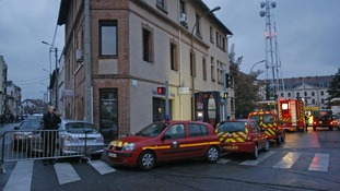 Firefighter ambulances are parked at the entrance of a street in Toulouse