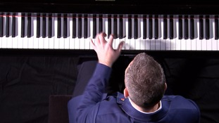 One-handed pianist performs concerto written for veteran