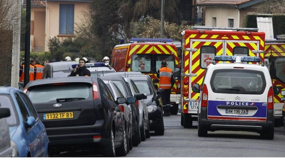 Ambulances and police vehicles are parked in the street of Toulouse