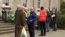 Protestors met councillors.
