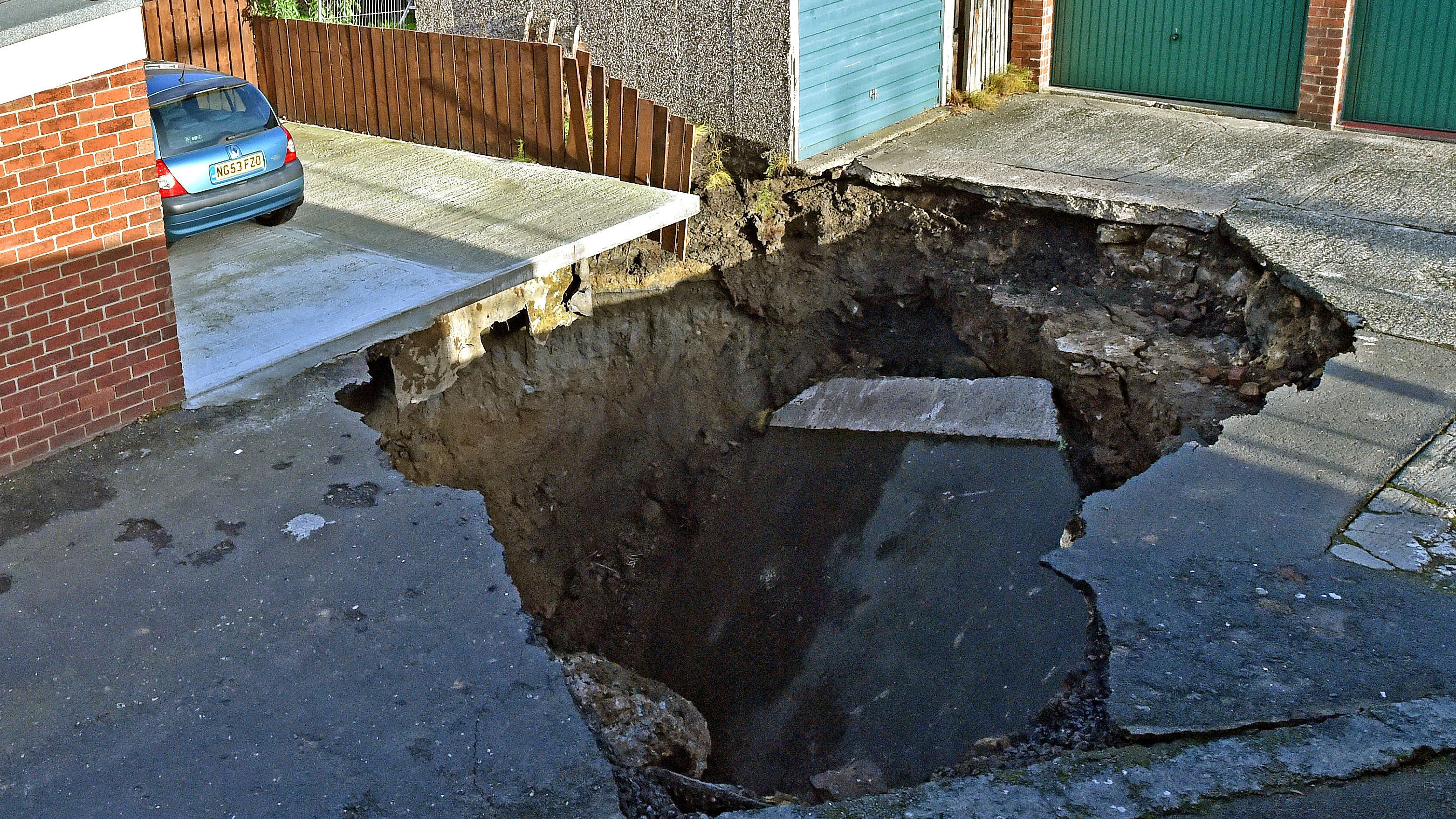 Huge 20ft Sinkhole Swallows Street Exposing Disused Mine