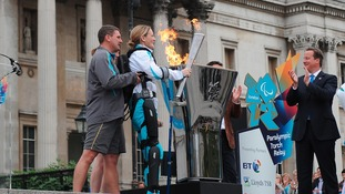 Claire Lomas lighting the flame in Trafalgar Square just before 8.30am